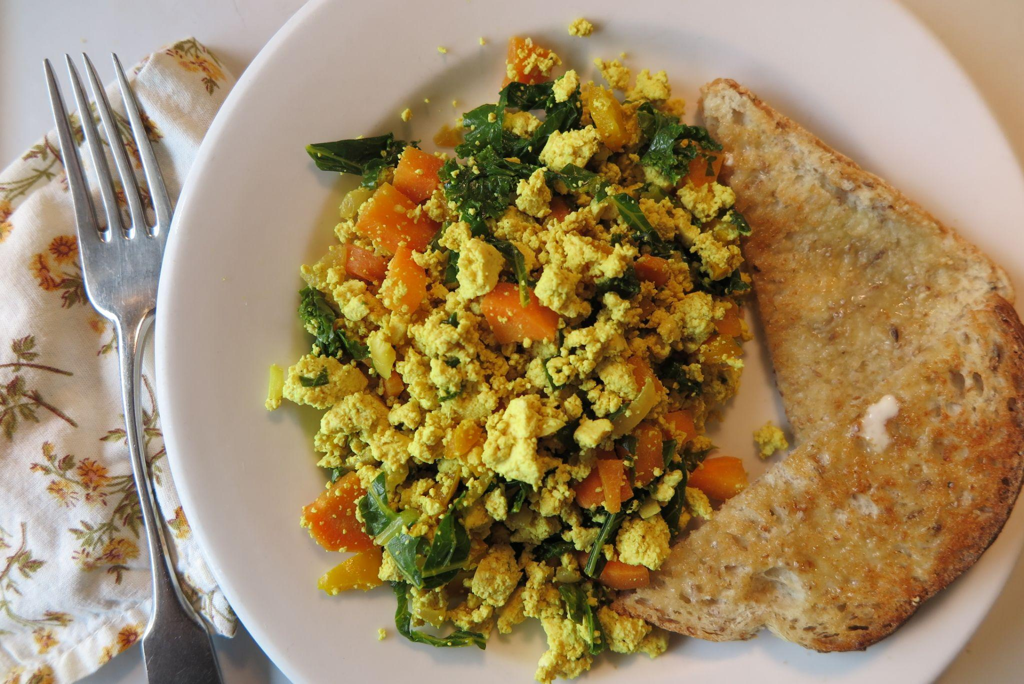 Tofu scramble on a plate with toast