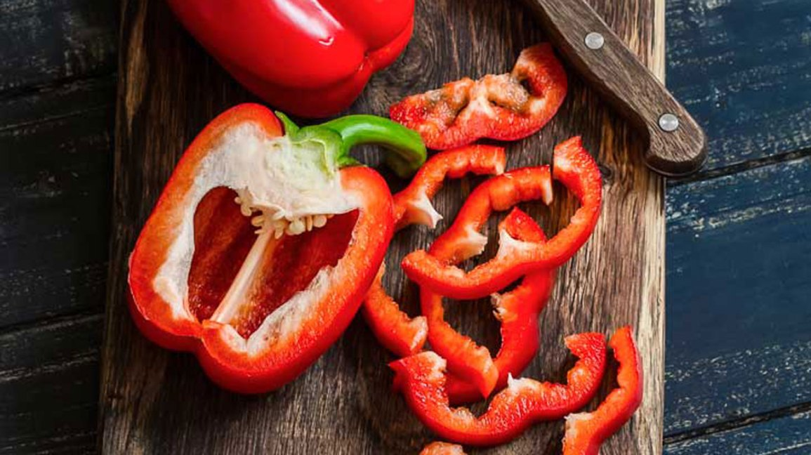 Sliced red bell peppers on a cutting board
