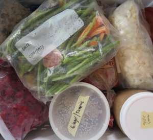 Overhead shot of bags and containers in a freezer drawer